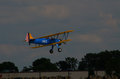 Stearman bi plane on take off an early wwii training takes as part of air show at eaa airventure in oshkosh wi Royalty Free Stock Photography