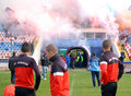 Steaua bucharest footbal fans cheering with smoke bombs s football sing and light and flares at the last training of the team Stock Photo