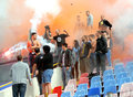 Steaua bucharest footbal fans cheering with smoke bombs s football sing and light and flares at the last training of the team Royalty Free Stock Images