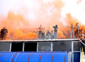 Steaua bucharest footbal fans cheering with smoke bombs s football sing and light at the last training of the team before the Royalty Free Stock Image