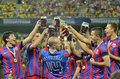 Steaua players celebrating victory with beer celebrate after the romanian supercup between bucharesta and petrolul ploiesti won Royalty Free Stock Image