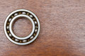 Steel ball bearings on wooden table Royalty Free Stock Photo