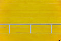 Steel barriers yellow stadium bleachers with white guard rail for sport background Royalty Free Stock Photo