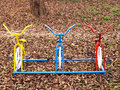 Steel bicycles in playground three on dry leaves Stock Photo