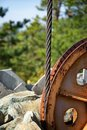 Steel cable and winch. Part of an old winch with a steel rope on a lift. Detail of the cableway. Close-up view of steel big wheel Royalty Free Stock Photo