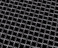 Steel chain mail metal ring pattern isolated metallic rings connecting iron mesh with black background Royalty Free Stock Photo
