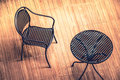 Steel chair and table on wooden floor : top view Royalty Free Stock Photo
