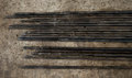 Steel conduits in garage lay on the ground dim Stock Photo