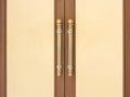 Steel door handles on vintage wood Royalty Free Stock Image