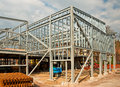 Steel framed building the skeleton frame of a showing the vertical columns and horizontal i beams on a new commercial Royalty Free Stock Photos