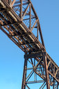 Steel girder railroad bridge with blue sky section of rusty in bright daylight clear background Royalty Free Stock Images