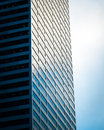 Steel and glass building and cloudy sky Royalty Free Stock Photo