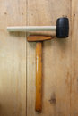 Steel hammer and Rubber Hammer on wood Royalty Free Stock Photo
