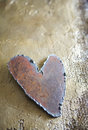Steel heart on golden texture Stock Photography
