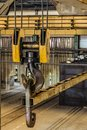 Steel hook with linear traverse of industrial overhead crane Royalty Free Stock Photo