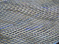 Steel mesh on concrete base Royalty Free Stock Photo