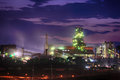 Steel mill at night factory lights Stock Photos