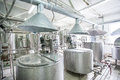 Steel new pipelines and vats on milk factory Royalty Free Stock Photo