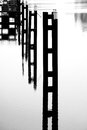 Steel piers in the water black and white photograph of a harbor basin Royalty Free Stock Photos