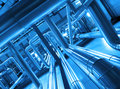 Steel pipelines and cables in blue tones industrial zone Royalty Free Stock Image