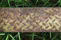 A steel plate texture of grunge rust on grass background Royalty Free Stock Photography