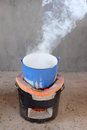 Steel pot on clay stove in Thai kitchen Royalty Free Stock Photo