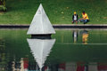 Steel Pyramid sculpture in the park`s pool near Petronas twin towers in Kuala Lumpur, Malaysia Royalty Free Stock Photo