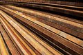 Steel rails lines a pile rusty background Stock Images