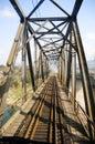 Steel railway bridge under blue sky