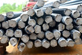 Steel rods piles of long cylindrical construction Stock Images