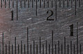 Steel ruler closeup a close up photo taken on a worn metal showing the metric and inch units Royalty Free Stock Photos