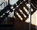 Steel stairs Shadows Bricks Glass Detail Royalty Free Stock Photo