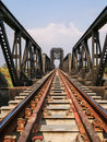 Steel structure of railway bridge, railway rail with vanishing point Royalty Free Stock Photo