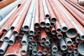 Steel tubes a stack of in construction site Royalty Free Stock Image