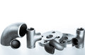 Steel welding fittings and connectors elbow flanges and tee on group tees plu on white space Stock Images