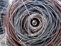 Steel wire reeled up on a pipe Royalty Free Stock Images