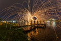 Steel wool fire on the lakeside Royalty Free Stock Photo