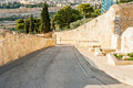 Steep narrow road a on a side of the mount of olives in jerusalem israel with the iconic old city in the background Royalty Free Stock Photography