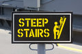Steep stairs sign informs that there are nearby Royalty Free Stock Images