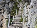 Steep stairway carved out of stone on a mountain path. Steel cables on its sides. Orobie. Italian Alps Royalty Free Stock Photo
