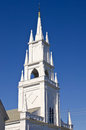 Steeple of historic white church against deep blue sky Royalty Free Stock Photography