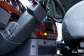 Steering column and dashboard in cab of semi truck