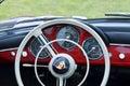 Steering wheel & dashboard of red vintage retro 1958 Porsche 356 Speedster sports motor car Royalty Free Stock Photo
