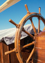 Steering wheel nautical equipment on the old tall ship ship s deck exterior with tackles and marine equipment skipper control Royalty Free Stock Image