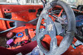 Steering wheel , old interior of ruined truck Royalty Free Stock Photo