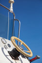 Steering wheel old yellow of a motor boat under the blue sky Royalty Free Stock Photo