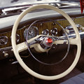 Steering wheel of retro car closeup photo Royalty Free Stock Image