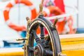 Steering wheel on sailing ship macro view of wooden Stock Images