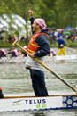 The Steersperson of Wonder Bra's Dragon Boat Royalty Free Stock Photo