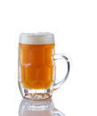 Stein filled with amber beer vertical image of a glass fresh on white reflection Royalty Free Stock Images